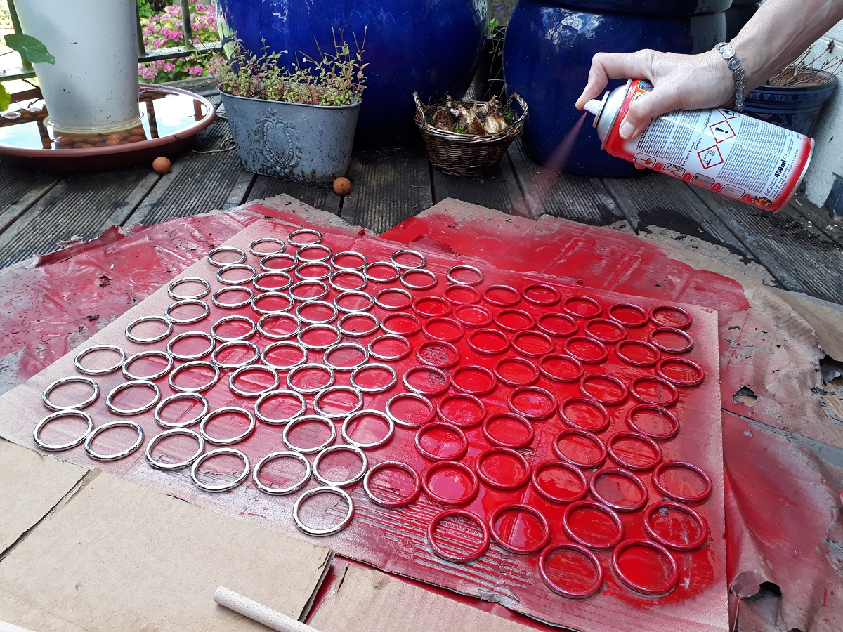 Photo of painting the attachment rings red.